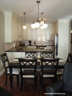 Closing the space above kitchen cabinets…love the white soffit and white cupboards that contrast with the dark counter