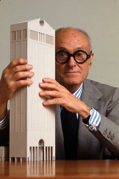 Philip Johnson- AT building - New York, 1984. The building was designed by architect Philip Johnson and partner John Burgee, completed in 1984, and close - in concept - to the 1982 Humana Building by Michael Graves.