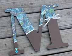 Have small wooden letters, kids can decorate with scrapbook paper, stickers, paint, markers, sequins, glitter, etc.