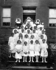 1914 photo of St. Ann's Academy First Communion Class with Sisters Elizabeth, Frances, Euphemia & Dolores.  One of the young girls later became Sister Paschal while another became Sister Domitilla.
