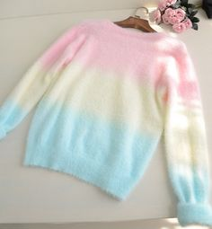 Oh my dear god I need this sweater~ .////. Holy fuck and they have a white and pink and purple fade too eeeeeeep omigosh omigosh omigosh I need them both so gosh darn bad!!!!!!!!!!!!!!!!~ >//.//<