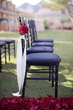 I love simple decor at weddings. Chairs don't have to have huge arrangements at the ends, and especially tacky plastic/fabric flowers