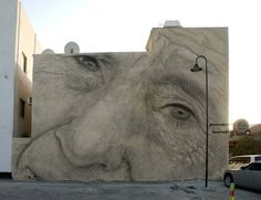 Barcelona-based muralist, Jorge Rodriguez-Gerada, temporary portrait at the Alwan 338 Festival in Manama, Bahrain. The artist painted the face of a local Bahraini fisherman, one of a few hundred left, in part of his identity series. The mural was painted with non-permanent materials and after the first rain it had been completely whitewashed off the wall.