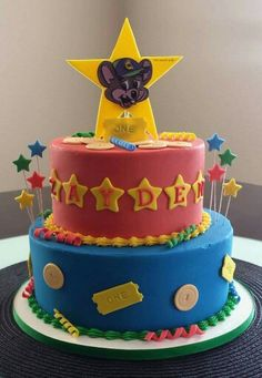 Chuck E Cheese cheese cake Buttercream and fondant icing with