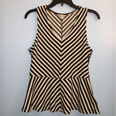 Striped peplum top Super cute black and white striped top perfect for a special occasion or formal day wear. No flaws, just needs a new home :) Banana Republic Tops Blouses