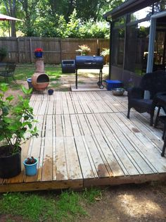 We moved into a house that had a dilapidated patio and a serious mud issue.  Our solution?  Pallets!!!  As you can see from the first...