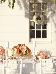 beautiful tables & wreaths on windows