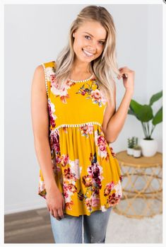 """Shop new arrivals at Beautique! Use the code """"aubree10"""" at checkout and receive 10% off your order every time you purchase!  #summer #summerfashion #womensfashion #babydoll #tanktop #pompom #mustard #floral #shopsmall Online Boutiques, Top Rated, Baby Dolls, Racerback Tank, Mustard, Bodice, Floral Tops, Trendy Fashion, Denim"""