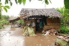 A typically impoverished family in need of a new  brick house. a brick house can protect the family from the monsoon months when heavy rain falls.
