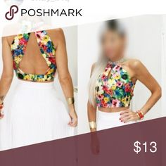 Floral halter open back crop top Bought in the local boutique and still haven't wear yet.the pic is the boutique owner in size small.mine is small too.very funny style crop top Freestyle Tops Crop Tops