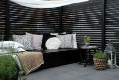 Furniture:Wonderful Wooden Parapets Design With Black Nooks With Cushions And Round Coffee Table With Chandeliers And Planters Decorating Yo...