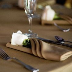 Table-setting ideas for a light-bown palette. A different shade of brown for the napkin would be lovely- love the flower tucked in the napkin! (#brownweddings)