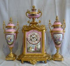 Antique clock & vase set. This would look awesome on a Victorian mantle!!
