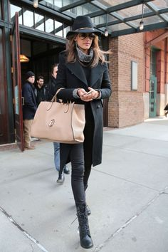 Alessandra Ambrosio wears a chic wide brim winter hat.