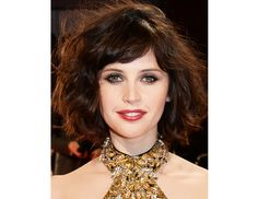 @Byrdie Beauty - Felicity Jones    The British actress went for volume and texture (a winning combination) at the London premiere of The Invisible Woman.