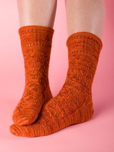 Falling Leaves Sock Pattern. The creative twists and turns of the cable pattern on these socks creates a cascade of leaves falling from ankle to toe. The crowning glory is the creative acorn pattern that dances around the cuff for a finishing touch. Knit these socks as a gift or as an addition to your own sock collection. Shown in Stroll Tonal Sock Yarn Foliage.