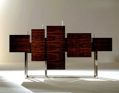 DESIGN EXRAVAGANZA Macassar ebony & steel sideboard   Taylor Llorente Furniture