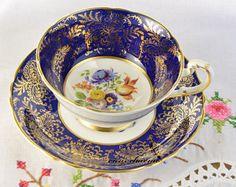 Paragon cup y saucer, taza de té pintado mano, taza de té tiene CUARTEADURA