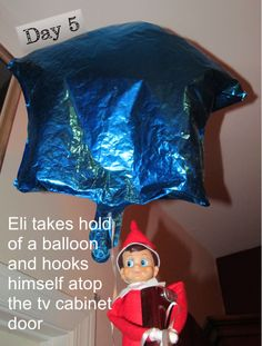 Eli the elf rides a balloon to the ceiling