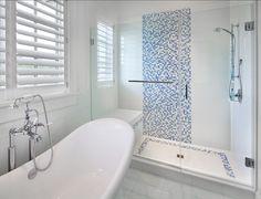 Shingle Beach House with Classic Coastal Interiors.piso del baño