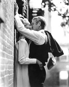 "Faye Dunaway and Steve McQueen's characters share a passionate kiss in ""The Thomas Crown Affair"""