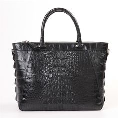 Every woman needs a signature black purse in her closet! Crafted from alligator leather, Gisella, takes you from the board room to dinner with friends.