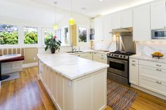Light and bright classic kitchen design with a breakfast nook. From 1 of 15 projects by Rossington Architecture, discovered on search.porch.com