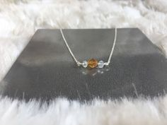 A personal favorite from my Etsy shop https://www.etsy.com/listing/546724530/november-topaz-gemstone-dainty-necklace