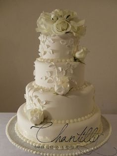 Chantilly - El-Paso-area Cakes - Four-tier wedding cake with white rose details