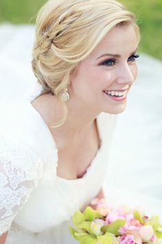 Braids: Dainty fishtail braid swooping into a chignon.