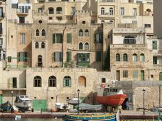 ST. JULIEN, MALTA... THIS LIMESTONE ISLAND IS REFLECTED IN ITS ARCHITECTURE...