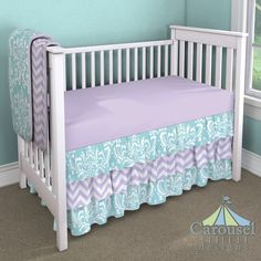 Crib bedding in Solid Lilac, Aqua Osborne Damask, Lilac and White Zig Zag. Created using the Nursery Designer® by Carousel Designs where you mix and match from hundreds of fabrics to create your own unique baby bedding. #carouseldesigns