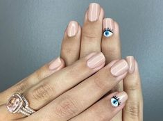These short nails slay with their fun, easy single eye design. Click above to get more nail ideas for short nails.