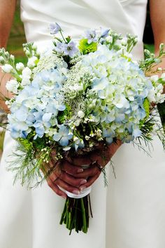 Hydrangeas increase the romantic feel of this bouquet...great idea for adding that something extra to a wild flower bouquet.