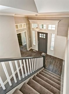 Love how the dark gray contrasts with the white trim in this home. The matching banister and front door make for a flawless design!