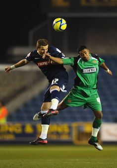 Millwall 5 Dagenham & Red 0 in Jan 2012 at the New Den. Harry Kane jumps up with Ahmed Abdullah in the FA Cup 3rd Round Replay.