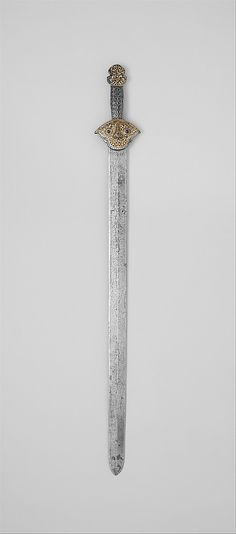 Sword (ral gri) Date: 14th–16th century Culture: Tibetan or Chinese Medium: Iron, gold, silver Dimensions: Length, 34 7/8 in. (88.6 cm) Leng...