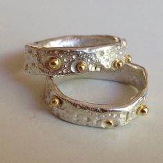 Larissa Landinez wedding bands. Sterling and 18kt yellow gold