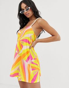 e2164731b1 ASOS DESIGN jersey beach sundress with rope tie in faded fluro stripe print  with natural flash