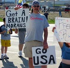 """If you're going to make a sign calling people """"morons,"""" you might want to make sure you spell it correctly."""