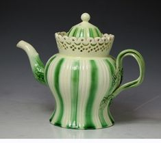 Antique English period creamware pottery teapot with reticulation and green border 18th century