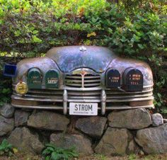 Front of old vehicle transformed into multiple mailbox holder. Cool.