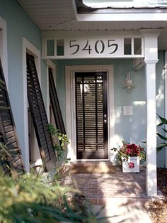 Not the style of our home but similar in colour.... liking the black door!