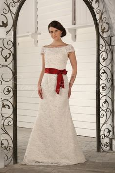 Wedding Dress by SimplyBridal. Delicate lace fabric and a neatly tied red sash give this bridal gown its ladylike, romantic feel. The bateau neckline and cap sleeves are perfect for a bride that loves to look feminine without showing too much, while a scattering of ornate beading gives. USD $413.99