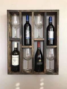 Here we have a reclaimed wood wine rack frame. This unit can hold 4 regular size wine bottles and 4 glasses. This piece is more like a piece of art than a wine rack. It is beautiful and functional. Dimensions: x x Shipping Weight: lbs Wine Rack Wall, Wood Wine Racks, Wine Bottle Holder Wall, Wood Wine Holder, Wine Holders, Bottle Opener, Wine Rack Design, Woodworking Projects, Diy Projects