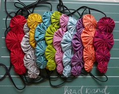 new colors available! ---> flora silk yoyo headband by cookoorikoo on Etsy, $22.00