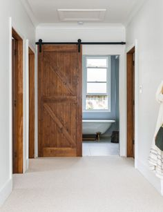 Both functional and stylish, barn doors are our new favourite interior trend. Here's how to use this design feature in your own home Wooden Barn Doors, Glass Barn Doors, Green Barn, Slider Door, Built In Cupboards, Barn Style Doors, Best Barns, Inside Home, Farmhouse Interior
