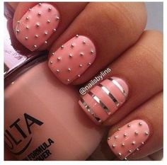 Pink nails with studs.