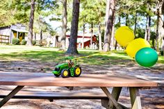Ride in on tractor with gender balloons attached.  Also..tractors for balloon weights, genius!