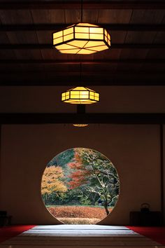 ~~Autumn colors in Meigetsuin Temple of Kita-Kamakura (North Kamakura), Japan. The garden framed by round window is like the earth of autumn colors by Yuo Japan~~